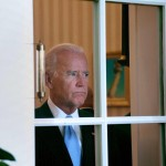 Joe Biden appears to be in the end-stages of Deerintheheadlightsitis. It is likely that moments after this photo was taken, he walked into the door, smearing his makeuup all over the glass.